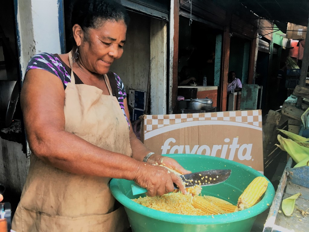 Woman grinding corn